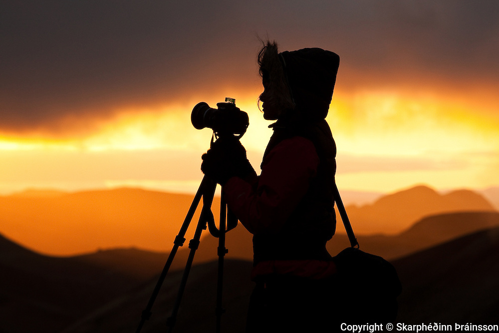 The Art of Photography - <br /> Photographers silhouette at sunest in Landmannalaugar, central highlands Iceland
