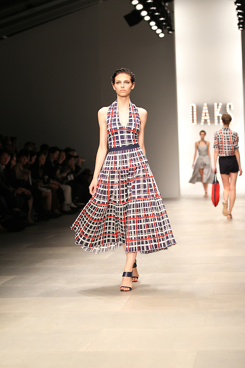 Models walk the catwalk for the DAKS Show during the spring 2012 London Fashion Week shows.
