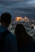 Couple looking at London cityscape from skyscraper, London, England, UK