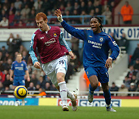 Photo: Ed Godden.<br />West Ham United v Chelsea. The Barclays Premiership.<br />02/01/2006. <br />James Collins (L) is chased by Chelsea's Didier Drogba.