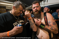 """""""Fajita Mike"""" of the Trimble, TN and the Full Throttle Saloon reality TV show after getting his hair shaved off at the Cackleberry Campground in the Chop-In Blocks """"Biker Beard-Off"""" to benefit the Aidan Jack Seeger foundation for ALD during Daytona Beach Bike Week, FL, USA. Thursday, March 12, 2015.  Photography ©2015 Michael Lichter."""