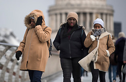 © Licensed to London News Pictures. 27/02/2018. London, UK. Members of the public wade through freezing winds on the Millennium Bridge near St Paul's Cathedral in the City of London, as a cold front, named the 'Beast From the East' hits the capital. Amber weather warnings are in place for large parts of the east of the UK as a severe cold front heads in from Russia. Photo credit: Ben Cawthra/LNP