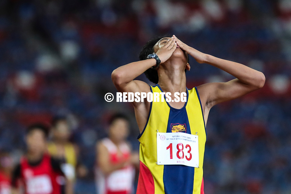 Amir Rusyaidi Osman (#183) of Anglo-Chinese School (Independent) reacts after the B Division boys' 1500m final. (Photo © Lim Yong Teck/Red Sports)