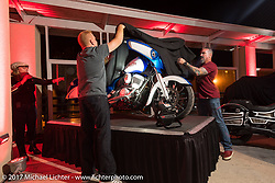 Custom bike builder Paul Yaffe gets help from Marc Altieri revealing his new custom Indian Chieftain at an Indian party at the Hilton Hotel during Daytona Bike Week. Daytona Beach, FL, USA. Friday March 10, 2017. Photography ©2017 Michael Lichter.