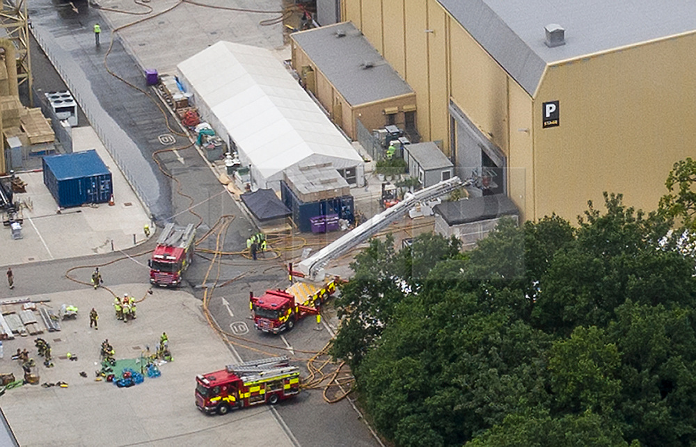 © Licensed to London News Pictures. 11/07/2019. Watford, UK. Fire engines can be seen near Stage P at the Warner Bros film studios at Leavesden near Watford as they deal with the aftermath of a blaze that started overnight. The fire service were called in overnight after a fire started in one of the studios. The Harry Potter series was filmed here. Photo credit: Peter Macdiarmid/LNP