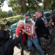 STONE MOUNTAIN, GA - August 15:  People fight over a condederate flag as members of far right militias and white pride organizations rally near Stone Mountain Park in Stone Mountain, Georgia  on August 15, 2020.  Militia members such as III% were met with anti-racist and anti-facist protesters orgranized by F.L.O.W.E.R, a frontline organization based in Atlanta to combat racism. Photo by Logan Cyrus for AFP)