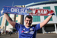 a Chelsea fan holds up his Chelsea vs West Ham United half & half scarf outside Stamford Bridge before k/o. Premier league match, Chelsea v West Ham United at Stamford Bridge in London on Monday 15th August 2016.<br /> pic by John Patrick Fletcher, Andrew Orchard sports photography.