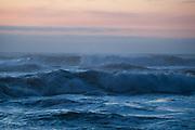 Crashing waves at sunset on Oceanside Beach in Oregon