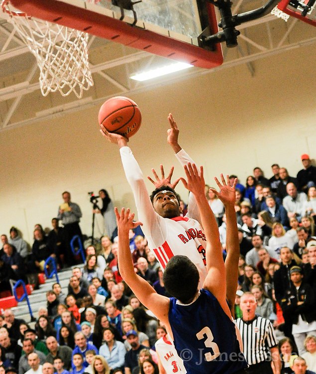 Watertown High School junior Julio Fulcar takes the ball to the basket during the MIAA Division 3 North Sectional Final game against Bedford High School at Burlington High School, March 11, 2017. The Raiders won, 59-52.    [Wicked Local Photo/James Jesson]