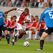 NLD/Amsterdam/20060823 - Ajax - FC Kopenhagen, Ryan Babel in duel met Tobia Linderoth