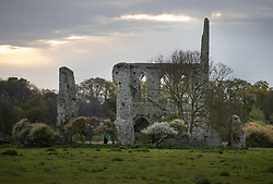 © Licensed to London News Pictures. 16/04/2017. Ripley, UK. People look round the ruins of Newark Priory after attending an Easter Sunday dawn service. The priory, which was established towards the end of the 12th century, lies near the banks of the River Wey and is only accessible once a year at Easter.  Photo credit: Peter Macdiarmid/LNP