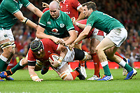 Rugby - 2019 pre-Rugby World Cup warm-up (Under Armour Summer Series) - Wales vs. Ireland<br /> <br /> Jake Ball, of Wales tackled by irish defence , at Principality (Millennium) Stadium.<br /> <br /> COLORSPORT/WINSTON BYNORTH