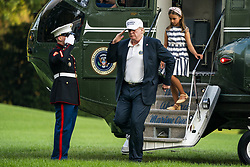 U.S. President Donald J. Trump (L) and his granddaughter Arabella Rose Kushner (R) walk off Marine One as they return from a weekend stay in Bedminster, New Jersey at the White House in Washington, DC, USA, 29 July 2018. Earlier in the day, the President once again went after the media on Twitter, calling them the 'enemy of the people.'