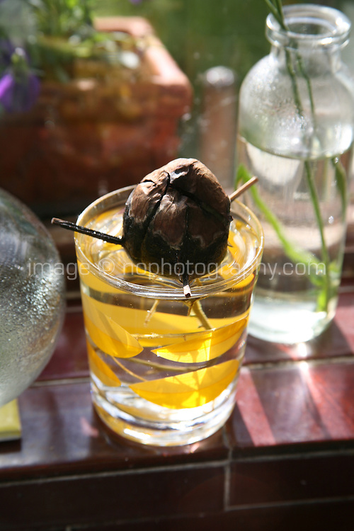 Avocado stone germinating in a glass of water on a kitchen window sill