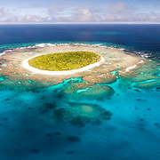 Aerial panorama of Fangasito Island in the Vava'u island group of the Kingdom of Tonga, showing fringing coral reef structure and white sand beaches around the island