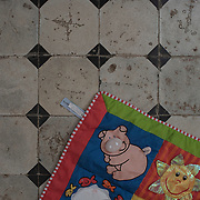 A toddlers play mat on the floor at Villa Artemis, a shelter for 30 refugee women and their children in the grounds of Leros Hospital. <br /> <br /> Opened in September 2015, the shelter was run by the Leros Solidarity Network. However, Villa Artemis was closed down shortly after the opening of a 'Hotspot' (EU-run migrant's reception centres) camp in Lepida in February 2016.