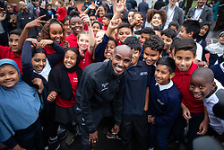 © Licensed to London News Pictures. 15/10/2018. London, UK. British athlete Sir Mohamed Farah and Mayor of London Sadiq Khan (not pictured) launch a campaign at Cubitt Town Junior School to encourage London schools to take part in the Daily Mile initiative. The Daily Mile gets school children exercising outside for 15 minutes a day, to improve their physical, social, emotional and mental health and wellbeing. Photo credit : Tom Nicholson/LNP