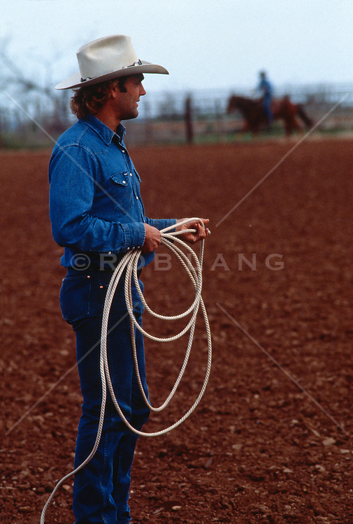 Cowboy with a lasso on a ranch in Texas