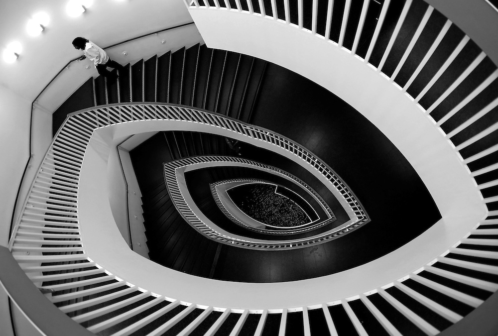 A man walks up a spiral staircase at the Museum of Contemporary Art in Chicago, Illinois, September 3, 2014. REUTERS/Jim Young