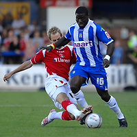 Photo: Ashley Pickering.<br /> Colchester United v Charlton Athletic. Coca Cola Championship. 15/09/2007.<br /> Luke Varney of Chrlton (L) tackles George Elokobi of Colchester