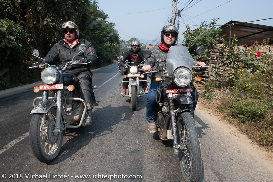 Rip Rolfsen (L), Beanre (Kevin Doebler) (middle) and Danny Ochs on day-9 of our Himalayan Heroes adventure riding from Pokhara to Nuwakot, Nepal. Wednesday, November 14, 2018. Photography ©2018 Michael Lichter.