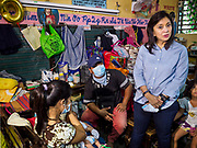 24 JANUARY 2018 - GUINOBATAN, ALBAY, PHILIPPINES: LENI ROBREDO, the Vice President of the Philippines, visits with families evacuated from the Mayon volcano in their room at the Barangay Maninila Evacuation Center in Guinobatan East Central School. The Mayon volcano continued to erupt Tuesday night and Wednesday forcing the Albay provincial government to order more evacuations. By Wednesday evening (Philippine time) more than 60,000 people had been evacuated from communities around the volcano to shelters outside of the 8 kilometer danger zone. Additionally, ash falls continued to disrupt life beyond the danger zones. Several airports in the region, including the airport in Legazpi, the busiest airport in the region, are closed indefinitely because of the amount of ash the volcano has thrown into the air.    PHOTO BY JACK KURTZ