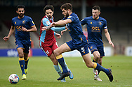 Mansfield Town Ryan Sweeney (5) Scunthorpe United Alex Gilliead (8) battles for possession during the EFL Sky Bet League 2 match between Scunthorpe United and Mansfield Town at the Sands Venue Stadium, Scunthorpe, England on 26 December 2020.