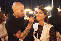 December 8, 2019, Atlanta, Georgia, USA: Sylvie Silva, Miss Portugal 2019 gets makeup done by an OP Cosmetics artist backstage during The Miss Universe Competition telecast, held at Tyler Perry Studios. Contestants from around the globe have spent the last few weeks touring, filming, rehearsing and preparing to compete for the Miss Universe crown. (Credit Image: © Benjamin Askinas/Miss Universe Organization via ZUMA Wire)