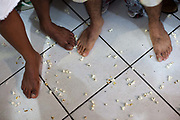 Popcorn on the ground with feet, part of a ceremony at Terreiro (yard) peace and love / Terreiro Paz y Amor, Salvador, Bahia, Brazil. Often the lines between Candomble, Catholicism and Umbanda are blurred. Salvador de Bahia is seen as the home of Candomble.