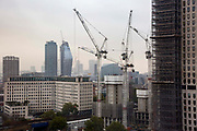 Tower cranes on a construction site adjacent to the Shell building on Stamford Street, South Bank, London, United Kingdom.  (photo by Andrew Aitchison / In pictures via Getty Images)