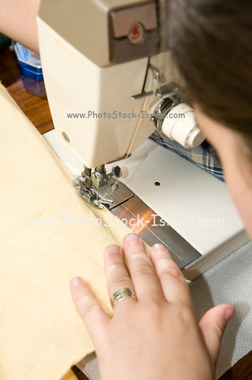 Young female teen of fifteen sewing Model release available