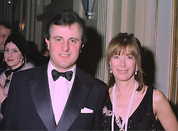 VISCOUNT & VISCOUNTESS ASTOR at a party in London on 27th January 1998.<br /> MEW 149