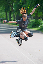 © Licensed to London News Pictures 15/06/2021. Greenwich, UK. Ugne aged seventeen rollerblading in Greenwich park, London today enjoying the warm weather. Photo credit:Grant Falvey/LNP