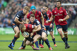 March 30, 2019 - Edinburgh, Scotland, United Kingdom - Andrew Conway of Munster tackled by Chris Dean of Edinburgh during the Heineken Champions Cup Quarter Final match between Edinburgh Rugby and Munster Rugby at Murrayfield Stadium in Edinburgh, Scotland, United Kingdom on March 30, 2019  (Credit Image: © Andrew Surma/NurPhoto via ZUMA Press)