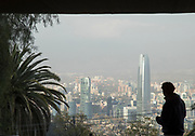 Silhouette of man looking on view with skyscrapers from San Cristobal Hill, Santiago, Chile