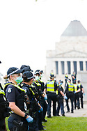 Police are seen lined up to protect The Shrine during the Melbourne Freedom Rally at The Shrine. Premier Daniel Andrews promises 'significant' easing of Stage 4 restrictions this weekend. This comes as only one new case of Coronavirus was unearthed over the past 24 hour and no deaths. (Photo by Dave Hewison/Speed Media)