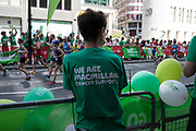 Charity supporters from Macmillan Cancer Support encourage participants taking part in the London Marathon on 22nd April 2018 in London, England, United Kingdom. The London Marathon, presently known through sponsorship as the Virgin Money London Marathon, is a long-distance running event. The event was first run in 1981 and has been held in the spring of every year since. The race is mainly known for ebing a public race where ordinary people can challenge themsleves while raising great amounts of money for various charities.