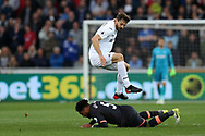 Ashley Williams of Everton tackles Fernando Llorente of Swansea city (c). Premier league match, Swansea city v Everton at the Liberty Stadium in Swansea, South Wales on Saturday 6th May 2017.<br /> pic by  Andrew Orchard, Andrew Orchard sports photography.