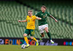 DUBLIN, REPUBLIC OF IRELAND - Sunday, October 11, 2020: Wales' Joseff Morrell (L) is challenged by Republic of Ireland's Jeff Hendrick during the UEFA Nations League Group Stage League B Group 4 match between Republic of Ireland and Wales at the Aviva Stadium. The game ended in a 0-0 draw. (Pic by David Rawcliffe/Propaganda)