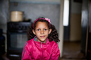 """The daughter of family Matouci in one of the highrise buildings at Lunik IX. Two families are living in this flat, mother Matouci explains: """"At Lunik IX it is absolutely impossible to life, we do not have water, the electricity is switched off for almost two years and the gas is also cut off. It is unberable, we are washing by hands that we are at least clean, we can not use a washing machine because of the lack of electricity. Nobody cares about Lunik IX."""" LUNIK IX is populated with almost 100% Roma inhabitans and  in the western-central part of the city of Kosice located in Eastern Slovakia. The living conditions in Lunik IX are partly very bad and many people do not have electricity, water or gas. Some of the buildings are completely devasted. The family left Lunik IX for the UK where they are living till now."""