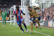 Mesut Ozil of Arsenal  is challenged by Pape N'Diaye Souare of Crystal Palace. Barclays Premier league match, Crystal Palace v Arsenal at  Selhurst Park in London on Sunday 16th August 2015.<br /> pic by John Patrick Fletcher, Andrew Orchard sports photography.