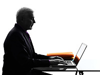 One Caucasian Senior Business Man serious computing laptop Silhouette White Background