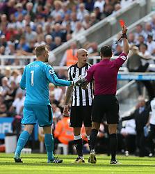 13 August 2017  : Premier League Football : Newcastle United v Tottenham Hotspur:  referee Andre Marriner shows the red card to Jonjo Shelvey: Photo: Mark Leech
