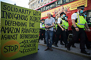 Metropolitan Police officers arrive to arrest female and FINT-identifying environmental activists from Extinction Rebellion taking part in a pink roadblock of Oxford Circus during the third day of Impossible Rebellion protests on 25th August 2021 in London, United Kingdom. Extinction Rebellion are calling on the UK government to cease all new fossil fuel investment with immediate effect.