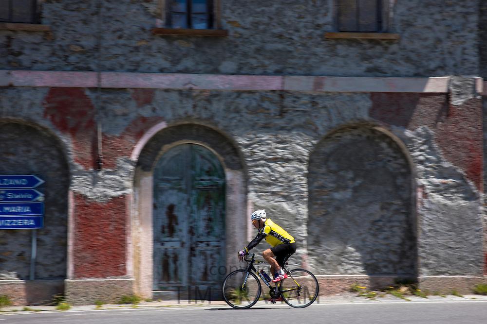 Cyclist on The Stelvio Pass, Passo dello Stelvio, Stilfser Joch, in Northern Italy