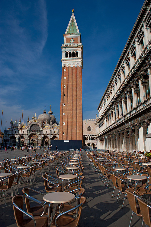 St. Mark's Basilica and Campanile with cafe tables in foreground, Piazza San Marco, Venice, Italy