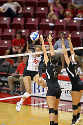 30 August 2011: Angela Rego strikes the ball towards Keley Augustine and Sammi Minton  during an NCAA volleyball match between the Cougars of Southern Illinois Edwardsville and the Illinois State Redbirds at Redbird Arena in Normal Illinois.