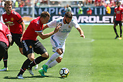 Manchester United Defender Phil Jones and Real Madrid Forward Karim Benzema during the AON Tour 2017 match between Real Madrid and Manchester United at the Levi's Stadium, Santa Clara, USA on 23 July 2017.