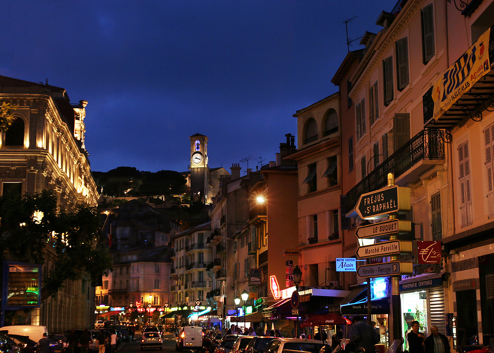 Night view of Cannes France with view of Clock Tower at Le Suquet Hill