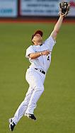 Second baseman Andrew Saylor reaches for a base hit by Windy City last night. DAVID RICHARD / GAZETTE.